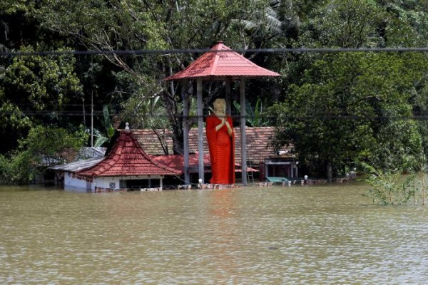 A flooded Buddhist temple is seen on the side of a flooded road in Bulathsinhala village, in Kalutara